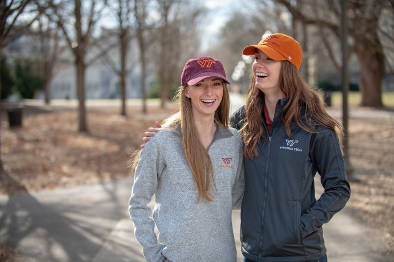 Girls with Virginia Tech hat and sweatshirt